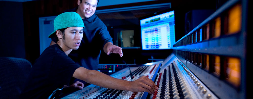 two young men in a music studio